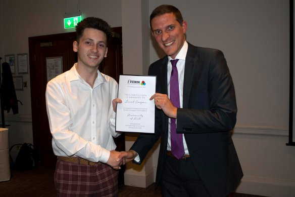 Paul presenting Jacob Cooper with his award